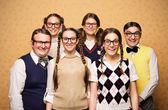 Nerd crew smiling together — Stock Photo