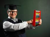 Male nerd holding abacus — Photo