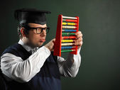 Male nerd holding abacus — Stock Photo