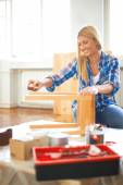 Woman sanding furniture — Stock Photo