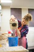 Pottery artist pouring clay — Stock Photo