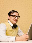 Young nerd sitting at the computer — Stock Photo
