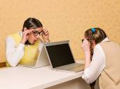 Young nerds sitting at the desk with computers — Stock Photo