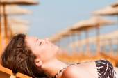 Woman on sunlounger — Stock Photo