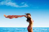Woman enjoying wind on beach — Stock Photo