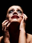 Hysteric woman with smeared makeup — Stock Photo