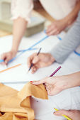 Designers draw on the sewing pattern — Stock Photo