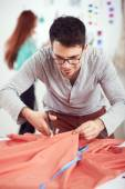 Designer cutting textile material — Stock Photo