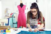 Designer measuring textile material — Stock Photo
