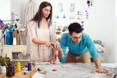 Designers measuring material — Stock Photo