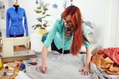 Designer drawing on textile material — Stock Photo