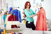 Designer measuring dress — Stock Photo
