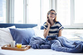Breakfast in bed for woman with glasses — Stock Photo