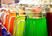 A Row Of Colorful  Juices Served in Jug — 图库照片