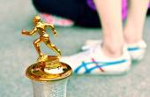 Trophy Close Up, Out Focus of Legs While Standing. — Stok fotoğraf