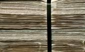 Daily newspapers stacked in a heap — Stock Photo
