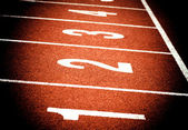 Close up of start on athletics running track — Stock Photo