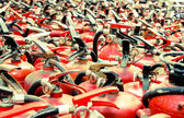 The fire extinguisher used. background with a lot of fire extinguishers — Stock Photo