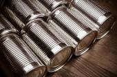 Aluminum cans on wooden background — Stock Photo