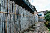 Bamboo wall and bamboo road — Stock Photo