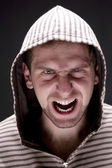 Angry man with hood screaming — Stock Photo