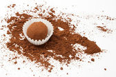 Chocolate truffle with scattered cacao — Stock Photo