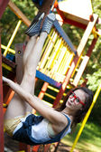 Pretty girl with red glasses in playground sports — Stock Photo