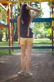 Pretty girl in playground in the back — Stock Photo