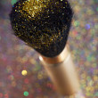 Closeup on makeup brush and shining powder — Stock Photo #56821671