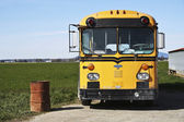 School bus and trash can — Stock Photo