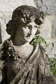 Garden goddess sculpture — Stock Photo