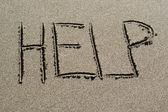 Ajudar na areia — Foto Stock