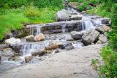 Roadside waterfall — Stock Photo