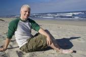 Young man relaxing on the beach — Stock Photo