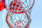 Seven year old girl is playing basketball — Stock Photo