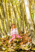 Seven year old girl in the forest — Stock Photo