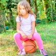 Seven year old girl sitting on the ball — Stock Photo #58526829