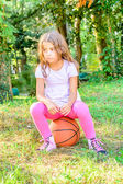 Seven year old girl  sitting on the ball — Stock Photo