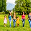 Group of female friends walking through the park — Stock Photo #58650683