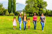 Group of female friends walking  walking through the park — Stock Photo