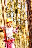 Child climbing in adventure park — Stock Photo