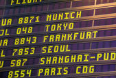 Departure board at the airport — Stock Photo