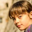 Profile of a beautiful little girl smiling with the focus on the — Stock Photo #65924725