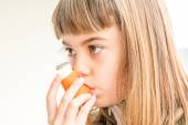 Seven year old girl breathing asthmatic medicine healthcare inha — Stock Photo