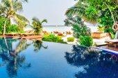 Tropical beach resort swimming pool in Maldives — Stock Photo