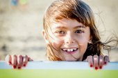 Beautiful eight year old girl smiling on the beach — Stock Photo