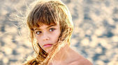 Beautiful eight year old girl  on the beach — Stock Photo