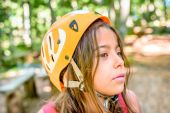 Profile of a beautiful eight year old girl in adventure park — Stock Photo