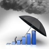 Umbrella protects Economic chart from bad weather. Conceptual illustration — Stock Photo
