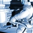 Space station at the Earth's orbit. Astronaut works in open space. He  adjusts communication devices, satellite antenna. High technology 3d animation — Stock Video #56632647